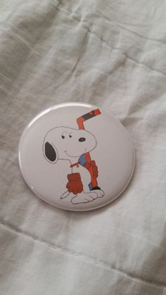 Check out this item in my Etsy shop https://www.etsy.com/listing/206940626/snoopy-hockey-peanuts-woodstock-pinback