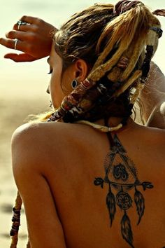 There are several different textures accessorizing the locs. Love it! The dreamcatcher tattoo is awesome also.