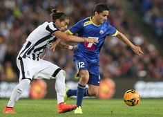 Marcelo Carrusca of the All Stars is challenged by Martin Caceres of...