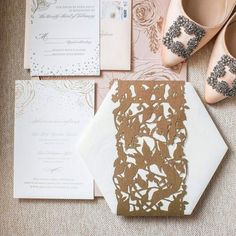 An invitation suite fit for a fairytale wedding 💕Dusty pink and rose gold accents, custom hand drawn florals and just the right amount of magic ✨Our favorite detail is the bold contrast between the woodland fairy-style, laser cut band and modern, hexagonal shape - but the best part is still to come... #staytuned #CeciNewYork #customdesign #beautifyyourworld #lasercut #coutureinvitations #custominvitations #weddinginvitations #weddinginspiration #weddingseason #luxuryinvites #customenvelope…