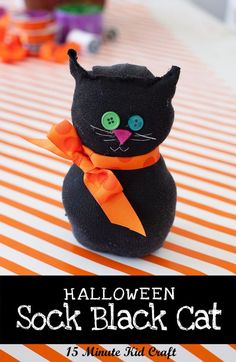 Spooky Black Sock Cat - Make a quick #Halloween #craft with your kids using an old black sock, buttons and ribbon.