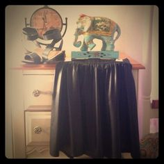 Faux Leather Skater Skirt This is a size small. It definitely has a edgy rocker look.  Has elastic band around waist. Come approximately mid thigh. Would look great with a band tee and some combat boots. Looks nice with flash photography. Joe B Skirts Mini