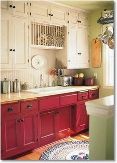 cute cabinets...I love red in the kitchen, and Chalk Paint® by Annie Sloan in Emperors Silk would give this look, with maybe Old White or Old Ochre for the top cabinets.  Ralph Lauren 'Lattice Red'