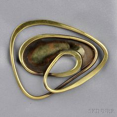"Art Smith. Brass Brooch. One of the leading modernist jewelers of the mid-twentieth century, Smith trained at Cooper Union. Inspired by surrealism, biomorphicism, and primitivism, Art Smith's jewelry is dynamic in its size and form. Although sometimes massive in scale, his jewelry remains lightweight and wearable. See ""From the Village to Vogue: The Modernist Jewelry of Art Smith""."