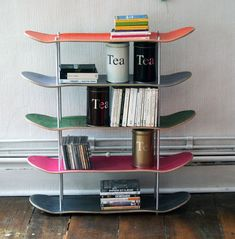 Shelf made by recycled skateboards. Great idea to store books in boys room