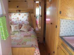 Vintage Travel Trailer with PINK appliances, photo no. 2. sooo snuggley, I can see me in there with my dogs.  Me too, and I don't have any dogs!