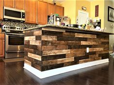 we just wanted to bring some woman oriented pallet wood repurposing project, and in regard to this here we have presented and eye catching and very useful pallet wood made kitchen installation. This is a gift for the ladies.