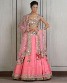 Raw silk baby pink Lehenga. Mirror work on the borders of Lehenga and dupatta. Comes with mirror workcholi.