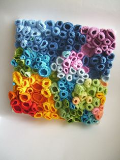 This is awesome looking. (Foreign Language) but these little cups look crocheted and then mounted to a white stretched canvas board (my mind is drawing a blank, what are those things called!!!!????)  веселі коралли | Страшно веселі :)