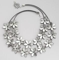 leather laser cut flowers.eninaj