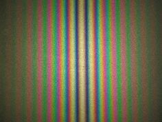 Fringe pattern produced with a Michelson interferometer using white light. As configured here, the central fringe is white rather than black.