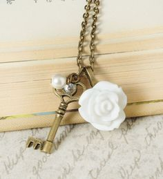 White Rose Jewelry Rose Necklace, Key Charm, Vintage Pearl. $24.00, via Etsy.