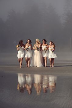 Gorgeous photo, all white bridal party on the beach