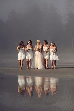 Gorgeous photo, all white bridal party on the beach