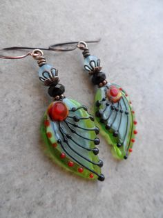 Heavenly Wings ... Artisan-Made Lampwork, AAA Blue Chalcedony, Swarovski Crystal and Copper Wire-Wrapped Rustic, Boho, Butterfly Earrings by juliethelen on Etsy https://www.etsy.com/listing/502566584/heavenly-wings-artisan-made-lampwork-aaa