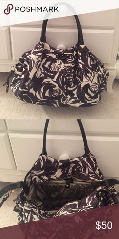 Kate Spade Diaper Bag Loved this bag!!  Classic Kate Spade diaper bag is black and white rose pattern. Straps to hook bag to stroller.  Has dust bag and changing pad. Excellent condition - no wear and tear. kate spade Bags Baby Bags