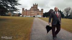 Fellowes takes a stroll on Highclere's lush 5,000-acre property. Since 1679, the castle has been home to the Carnarvon family and sits on the site of an earlier house, which was built on the foundations of a medieval palace.