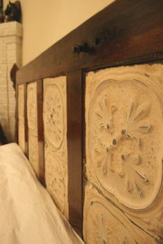 Old door tin tiles and paint. Simple and lovely. Two old doors stood up beside the bed like this but with a fancy lamp wired up and a little antique table in front of It. Antique Door Headboards, Headboard From Old Door, Diy Headboards, Headboard Door, Tin Tiles, Tin Ceiling Tiles, Headboard Tiles, Old Door Knobs, King Size Headboard