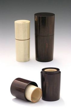 """A pair of simple boxes with the Holly neatly nested within the Ebony. <br /><br /> <br /><br /> The Holly is 1-1/2"""" dia x 4"""" tall and the Ebony is 2"""" dia x 4.75"""" tall. Both are finished with sanding sealer and friction polish."""