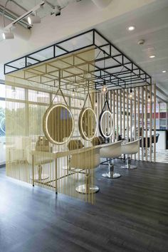 Our design solutions are the most versatile. What do you think of the elegant space divider of the L'Oréal Emotion saloon in Madrid? Simple but effective! Project by Daniel Venteo and Curtain Partition, Partition Design, Metal Curtain, Food Cart Design, Space Dividers, Lounge Design, Hospitality Design, Common Area, Interior Design