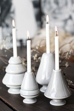 Delightful candlesticks in four shades of grey. Mix the grey and white shades for a minimalistic look.