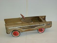 My brother had one of these pedal cars, his was red!
