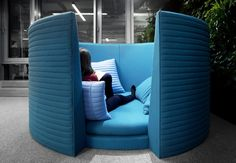 Private meeting space in open office fllor plan; Bausch & Lombs Warsaw Offices