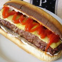 "All-American Burger Dog | ""I have been making these for years. I had leftover hot dog buns, so this was how I used them up. I gave the burgers a flat shape and could fit the goodies on top without dropping everything. I also flattened the bun a little."" - Joan P"