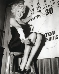 """Marilyn Monroe -- She is holding tickets, for an event, pointing at the 30th ... it says 'STOP ARTHRITIS"""". That's probably for the 1955 event at the CIRCUS where proceeds went to fight childhood Arthritis, So let me guess this is 1955..."""