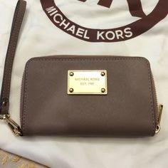 Mk dark dune wristlet Perfect condition. MICHAEL Michael Kors Bags Clutches & Wristlets