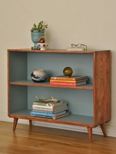 Built in Book Cases as the Decoration: Beautiful Built In Book Cases With Simple Design In Original Mid Century Modern Style Also Plant On Blue Vase And Ornaments Along With Grey Wall And Laminated Floor Decorations ~ workdon.com Furniture Inspiration