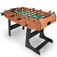 Folding+Foosball+Table+-+Wood+-+ The+perfect+match+for+parties+and+lunch+breaks This+handy+folding+foosball+table+is+ideal+for+the+office+or+home.+Made+of+sturdy+MDF,+it+is+durable+and+has+a+professional+finish,+making+it+a+great+place+to+stage+your+own+tournaments!+With+space+for+up+to+four+players,+this+table+folds+away+easily,+so+if+space+is+limited+you+can+store+it+away+until+it's+time+for+kick-off.+Add+some+football+to+your+life!Technical+Information  Dimensions   L/W/H...