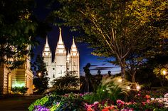 Check out this cool twilight photography of the Salt Lake City, Utah Temple with the mother and Children in the flowers and trees!