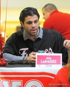 Ryan LaMarre speaks with fans during the Reds Caravan held at the Lima Mall on Saturday. RICHARD PARRISH / The Lima News