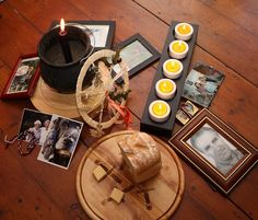 Samhain - honouring those gone before us. Ancestor pictures a meal shared with them and candles to light their way.