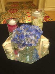 Small centerpieces with tinted hydrangeas , pink roses, and white Calla Lilies.