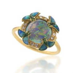 Art Nouveau Diamond, Opal, Gold and Enamel Ring. 18 karat gold and enamel ring with opal and diamonds by Eugene Feuillatre. The ring has a center black opal, surrounded by 8 rose-cut diamonds and 4 enamel wings. The closed gallery is decorated with a gold/enamel scrollwork design.