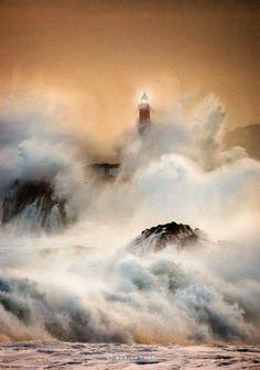 Cantabria, Spain...great shot of the lighthouse during a raging storm.