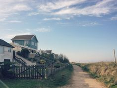 The beach houses overlooking the sea, just 90m away from Seaside Lodge
