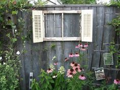 Using old shutters in the garden- paint the ones from the bathroom and place on fence by garage, facing street? add fan blade dragonflies, too!
