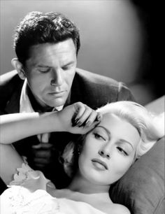 THE POSTMAN ALWAYS RINGS TWICE (1946) - Unfaithful wife Lana Turner tempts drifter John Garfield - Screenplay by Harry Ruskin & Niven Busch - Based on novel by James M. Cain - Directed by Tay Garnett - MGM - Publicity Still.