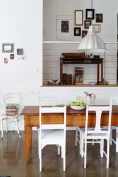 table with mismatched chairs that are all white