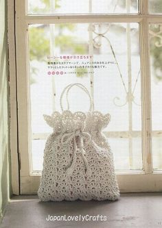 crochet purse- use gift bag pattern but a prettier stitch and add chained handles or thicker handles