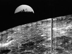 August 23, 1966. This photo reveals the first view of Earth from the moon, taken by Lunar Orbiter 1 on August 23, 1966. It's shot from a distance of about 236,000 miles (380,000 kilometers) and shows half of Earth, from Istanbul to Cape Town and areas east, shrouded in night.