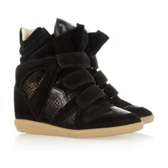 Bekett basket sneakers with hidden wedge by French label Isabel Marant. Bekett has a round nose with decorative hole pattern, velcro fastening, pronounced padded tongue with pinked front and inner leather sole.These famous sneakers add extra centimetres - wrapped up in a sporty and cool look. Pick your favourite among three colours.