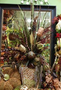 Dried floral arrangement designed by Arcadia Floral & Home Decor
