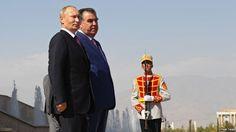 Russian President Vladimir Putin (left) and Tajik President Emomali Rahmon during a welcoming ceremony in Dushanbe on October 5.