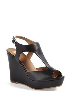 Love these simple platform peeptoe wedges. Comes in the perfect nude color to lengthen legs.