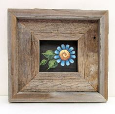 Rustic Barn Wood Framed Single Blue Flower by barbsheartstrokes. I would prefer to add a photo.