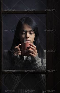 Young woman behind window with a cup of coffee or tea ...  Asian Ethnicity, asian, beautiful, beauty, beverage, breakfast, chinese culture, coffee, cold, contemplation, copy space, cup, drink, drinking, dusty, ethnic, female, girl, hot chocolate, loneliness, low key, mug, old fashioned, one people, pensive, portrait, relax, sadness, solitude, tea, teenage, vertical, vintage, window, winter, wool sweater, young woman